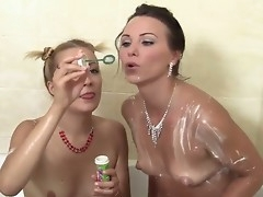 Alysa Chasm coupled with Devora are having fun rubbing cream cake all over their lovely breast at near lesbian sex