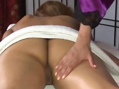 Horny masseuse sucking clients pussy during massage session