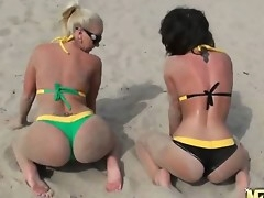 Two beautiful babes, nude, tanned, shapely breasts, both frolicking on the beach and eventually even rubbing each others clits. Whats not back corresponding to about that Its heavenly.